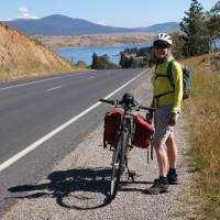Cyclist on the Barry Way with view of Lake Jindabyne   Ross Baker
