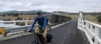 Cycling over bridge outside Cathcart | Kate Baker
