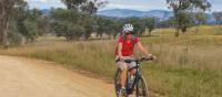 Cyclist on the Central West Cycle route between Mudgee and Gulgong | Ross Baker