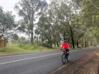 Cyclist on the road from Gerroa to Berry on the South Coast Cycle |  <i>Kate Baker</i>