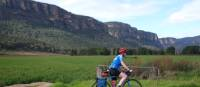 Cyclist passing the impressive escarpment of the Capertee Valley | Ross Baker
