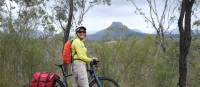 Cyclist viewing the impressive rock formations of the Capertee Valley | Ross Baker
