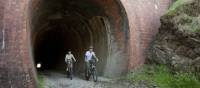 Cycling through the Cheviote Tunnel on the Great Victorian Rail Trail | Robert Blackburn