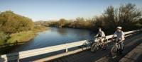 Cyclists crossing the Goulburn River | Robert Blackburn