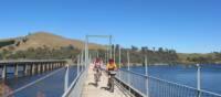 Cyclists on the Bonnie Doon Bridge over Lake Eildon | Rail Trails Australia