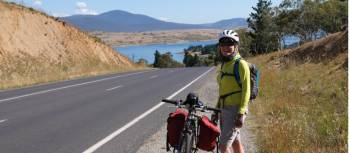 Cyclist on the Barry Way with view of Lake Jindabyne | Ross Baker