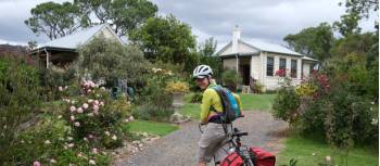 Cyclist arriving into the old school b and b in South Wolumla | Ross Baker