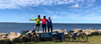 Cyclists at the end of the South Coast Cycle in Huskisson | Kate Baker