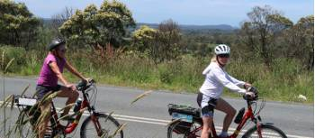Cyclists on a quiet road in the Southern Highlands | Kate Baker